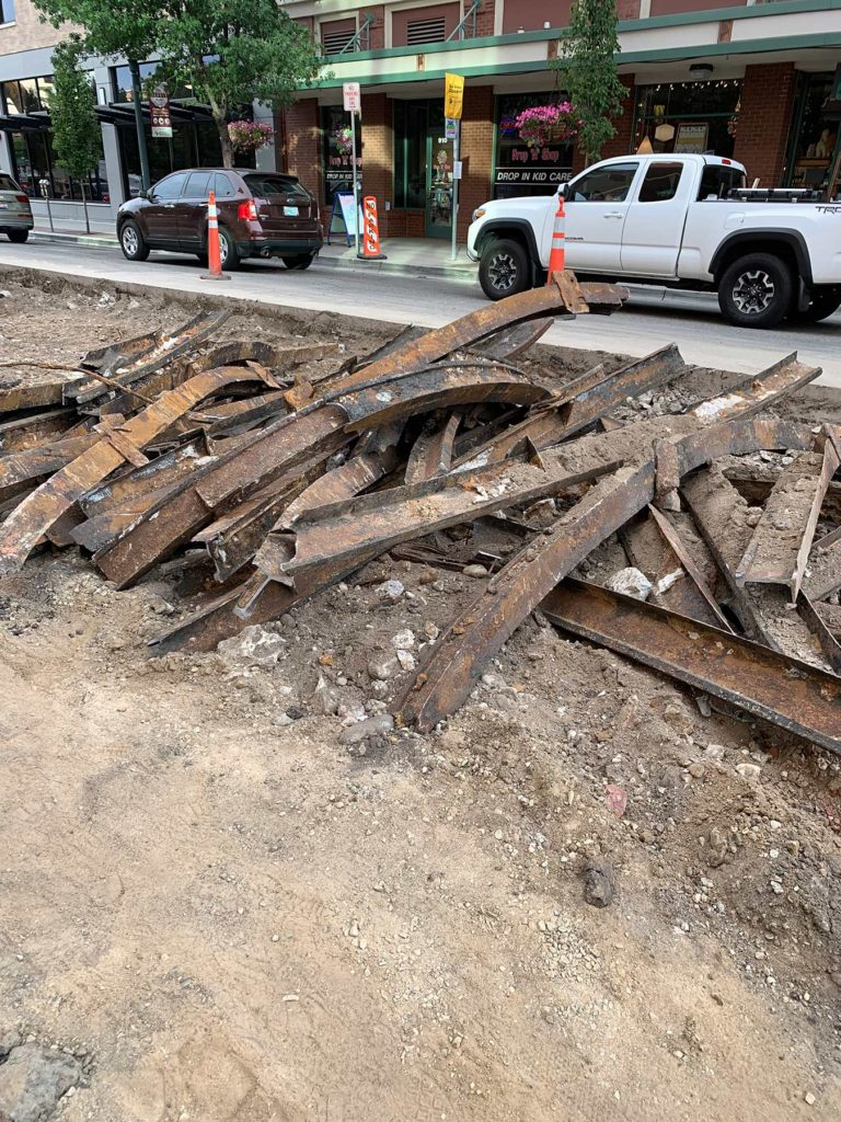 old railroad tracks that were removed for the new road surface