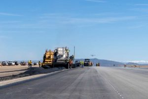 Hot mix asphalt paving with airplane take off at Cedar City Regional Airport