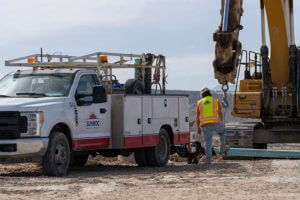 Utility crews installing water lines