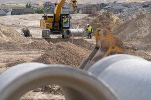 Sunroc Utility Crews installing storm drain and sewer pipe