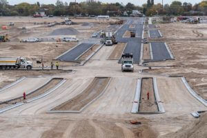 Paving asphalt on Founders Boulevard and parallel side streets