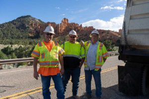 Dump Truck Driver Delivery Crew Hot Asphalt on SR-12 Near Bryce Canyon Utah
